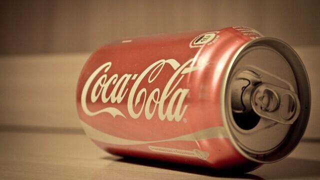 可口可乐三季净利降14% 巴菲特再损失10亿美元