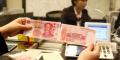 新版百元人民币发行 北京市民换万元新钞