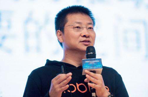 """p76 11 月6 日下午,由中信出版集团主办的""""智能生态与商业的未来""""高峰论坛活动在对外经济贸易大学举行。图为北京摩拜科技有限公司CEO 王晓峰。 CFP"""