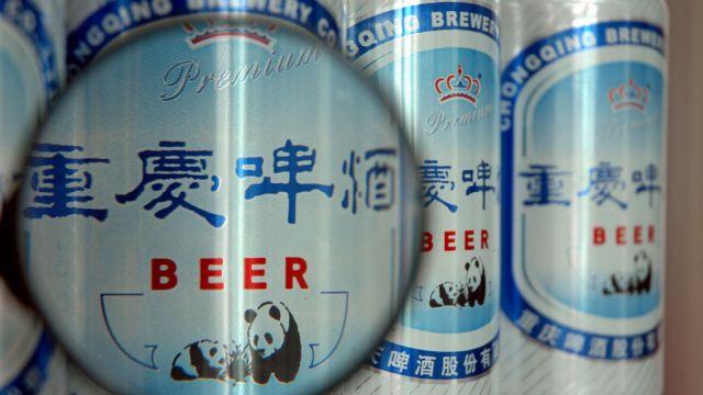 重庆啤酒20元贱卖两子明升88 业内:旨在清理不良资产