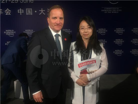 本刊记者与瑞典首相合影 张伟Ivan 摄