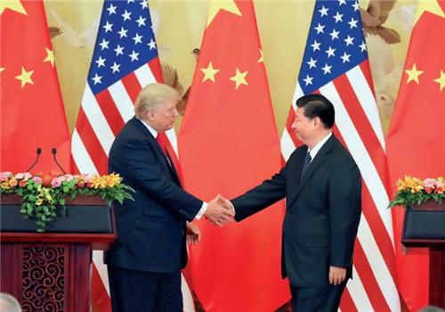 28 11月9日,中国国家主席习近平与美国总统特朗普在北京人民大会堂握手致意。