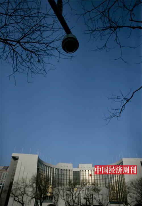 p39-经国务院批准,中国人民银行自 2005年7月21日起,开始实行以市场供求为基础、参考一篮子货币进行调节、有管理的浮动汇率制度。《中国经济周刊》首席摄影记者 肖翊  摄