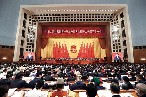 p38 5 月22 日,第十三屆全國人民代表大會第三次會議在北京人民大會堂開幕。中國國務院總理李克強代表國務院向大會作政府工作報告。